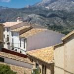 Old spanish village on mountain background. — Stock Photo #27132065
