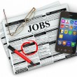 Search job. Newspaper with advertisments, glasses and mobile. — Foto Stock