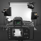 Digital photo camera in studio with softbox and flashes. — Stock Photo