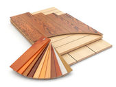 Installing laminate floor and wood samples. — Stock Photo
