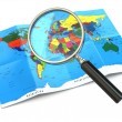 Stock Photo: Find locations. Loupe and mapof world.