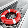 Stock Photo: Support. Laptop and life preserver for first help.