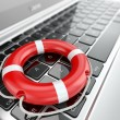 Support. Laptop and life preserver for first help. — Stock Photo #30634311