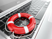 Support. Laptop and life preserver for first help. — Stock Photo