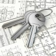 Stock Photo: Key on house plan blueprint. 3d