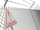 Caution. barbed wire fence with sign. — Stock Photo