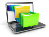 Laptop and computer files in folders. — Stock Photo