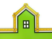 House from yard stick on white background . — Foto Stock