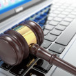 Stock Photo: Online auction. Gavel on laptop. 3d