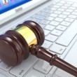 Stockfoto: Online judgement. Gavel on laptop. 3d