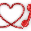 Stock Photo: Phone reciever and cord as heart. Love hotline concept.