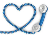 Phone reciever and cord as heart. Love hotline concept. — Stock Photo