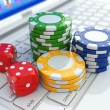 Online casino. Dices and chips on laptop. — Stock Photo