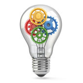Light bulb and gears. Perpetuum mobile idea concept. — Stock Photo