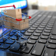 E-commerce. Shopping cart with cardboard boxes on laptop. — Stockfoto #38143799