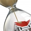 Real estate concept. Hourglass and home. — Stock Photo