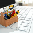 Stock Photo: Online support. Toolbox with tools on laptop.