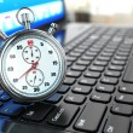 Stopwatch on laptop keyboard. — Stock Photo #39046557