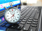 Stopwatch on laptop keyboard. — Stock Photo