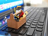 Online support. Toolbox with tools on laptop. — Stock Photo