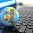 Stock Photo: Global communications. Earth on laptop ceyboard.