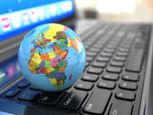Global communications. Earth on laptop ceyboard. — Stock Photo