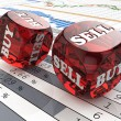 Stock market concept. Dice on financial graph. — Stock Photo #40901805