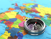 Silver compass  on world map background. — Stock Photo