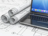 Laptop and blueprint with house project. — Stock Photo