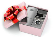 Home appliance in gift box with ribbons and bow. — Stock Photo