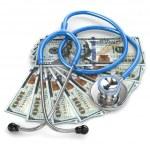 Health insurance. Stethoscope on dollar banknotes. — Stock Photo