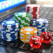 Virtual casino. Online gambling. Laptop with dice and chips. — Stock Photo #44946465