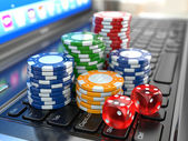 Virtual casino. Online gambling. Laptop with dice and chips. — Stock Photo