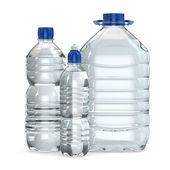 Bottles of water various sizes — Stock Photo