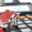 Real estate concept. House on calculator. Mortgage. — Stock Photo #45934253