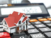 Real estate concept. House on calculator. Mortgage. — Stock Photo