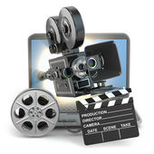 Video concept. Camera on  laptop, still reels and clapboard. — Stock Photo