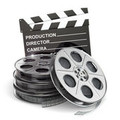 Movie concept. Film reels and clapboard — Stock Photo