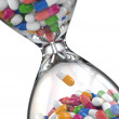 Time of medicine. Pills in hourglass — Stock Photo #48373683