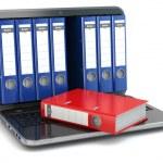 Data storage. Laptop with file ring binders. — Stock Photo #48373687