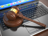 Online internet auction. Gavel on laptop. — Stock Photo
