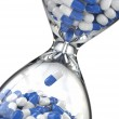 Time of medicine. Pills in hourglass — Stock Photo #48796043