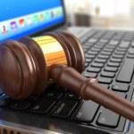 Online internet auction. Gavel on laptop. — Stock Photo