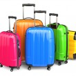 Luggage. Colorful suitcases on white isolated background. — Foto de Stock