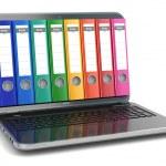 Data storage. Laptop with file ring binders. — Stock Photo #48796077