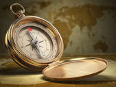 Compass on world map background. Navigation. — Stock Photo