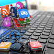 Store of laptop software. Apps icons in shopping cart. — Stock Photo #50570581