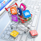 Store of laptop software. Apps icons in shopping cart. — Stockfoto