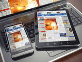News. Media concept. Laptop, tablet pc and smartphone — Stock Photo