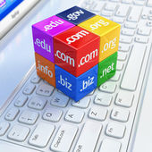 Domain concept. Cubes on white laptop keyboard. — Stock Photo
